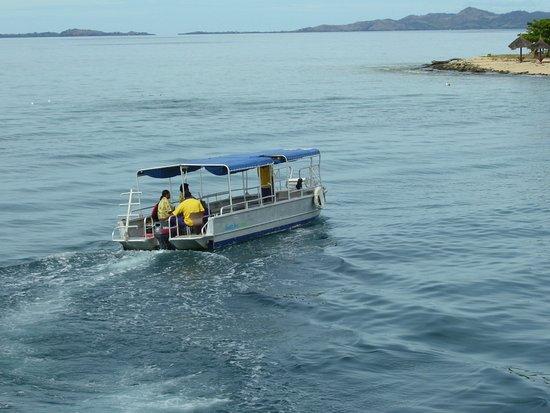 Denarau Island, Fiji: A boat ferrying people on and off.
