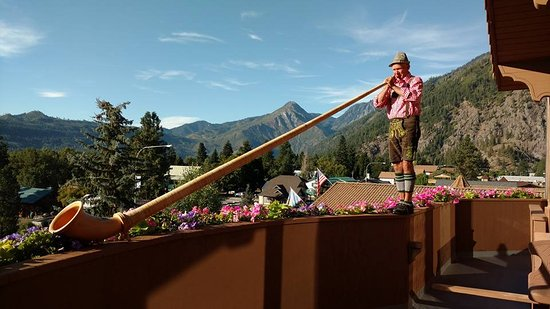 Enzian Inn: The breakfast Alphorn player, with a view!