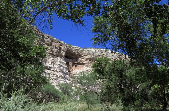 Montezuma Castle National Monument: A distance view framed by riparian vegetation.