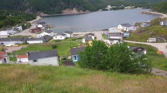 The Rolling Hills: View of Dunfield from hill by house
