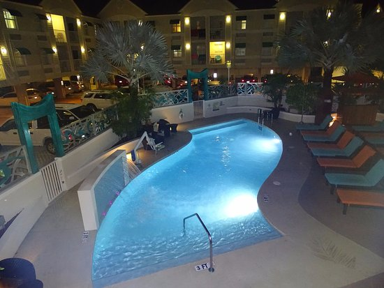 Pool by night at Silver Palms Inn Hotel.