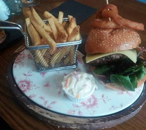 Sutton, UK: Beef burger with extra bacon and cheddar. Really cool presentation.