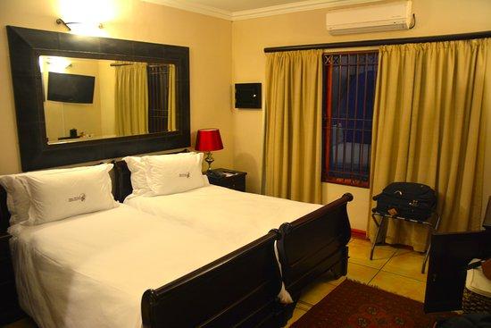 Zulu Nyala Country Manor: Vue partielle d'une chambre