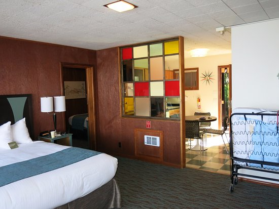 Village Inn At Apgar: Room 60 with kitchen in back and separate bedroom off to right.