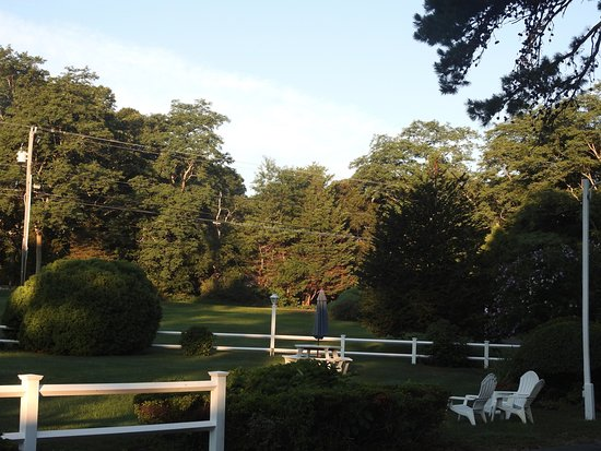 East Sandwich, MA: Second view, early morn, of the motel lawn, seating and picnic table.