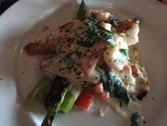High Point, NC: Grilled shrimp and scallops over asparagus and sautes spinach