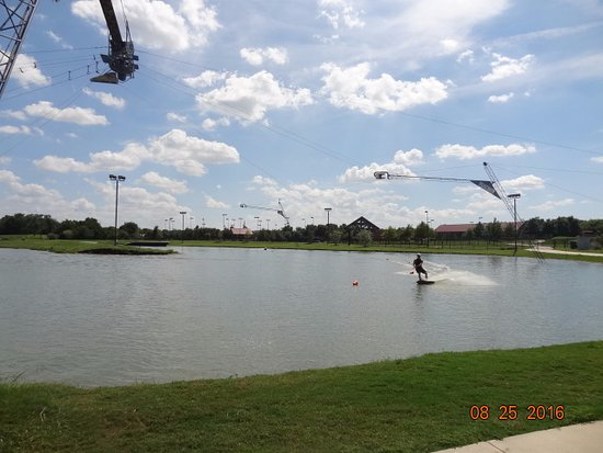 Hydrous Wakeboard Park: a person wake boarding