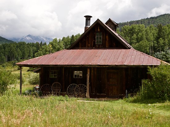 Dolores, CO: Houses hot springs 5 ft deep, bathroom, shower, sitting area with another pool in the back outsi