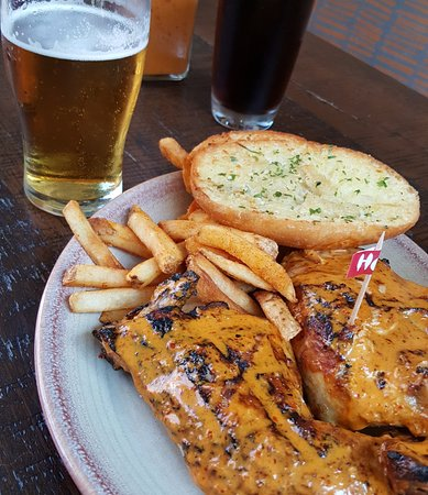 Towson, MD: chicken with peri peri sauce, fries, garlic bread and superbock!
