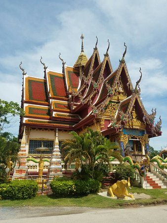 Wat Plai Laem: At this point of my trip, I've visited several temples and this is a very unique site. The color