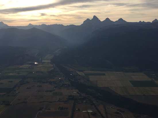 Driggs, ID: View from balloon as sun rises over the Teton mountains and valley.