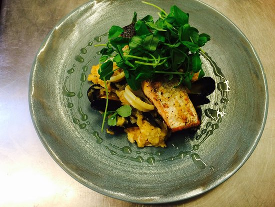 Sandbach, UK: Roasted salmon served with seafood risotto