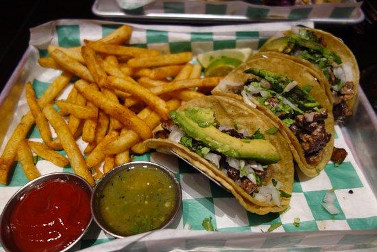 Iowa City, Iowa: My Carne Asada tacos and fries. Steak bits in tacos were like little rocks.