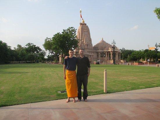 Tune Hotel - Ahmedabad, Gujarat: The Koteshwar Mahadev Temple (he was wearing shorts so had to cover up)