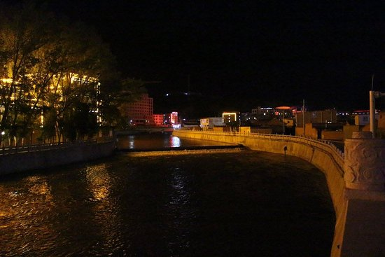 Xiahe County, China: Night View of the river from the city