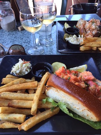 Cape May Fish Market: Lobster roll and Seafood roll with french fries and coleslaw plus a bottle of Riesling