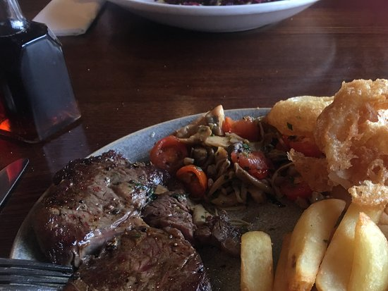 Gaerwen, UK: Rib eye steak with fracase of mushrooms & tomatoes, hand cut chips & pepercorn sauce