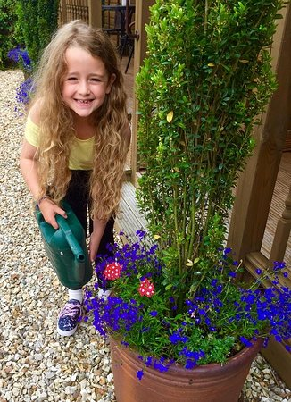 Kington, UK: Hollie our Grand Daughter watering the plants