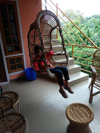 Periyar Mist Homestay: My son enjoying his day in swing in the misty paradise
