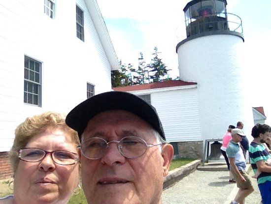 Bass Harbor, ME: My husband and I from the side view if the light house