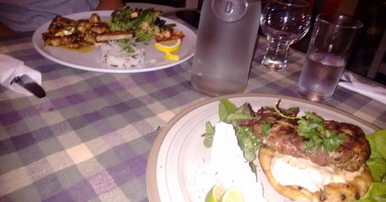 Heathfield, UK: Tigania in the background with lamb burger in front