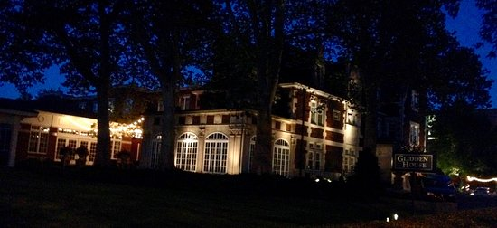 The Glidden House at night.