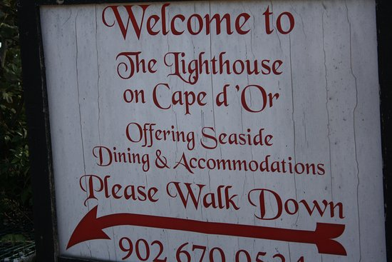 The Lighthouse on Cape d'Or: SIGN SHOULD ADVISE CAUTION, NOT EVERYONE IS ABLE TO WALK UP AND DOWN THIS STEEP PATHWAY!