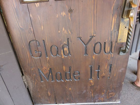 Wall, SD: Sign carved in a door