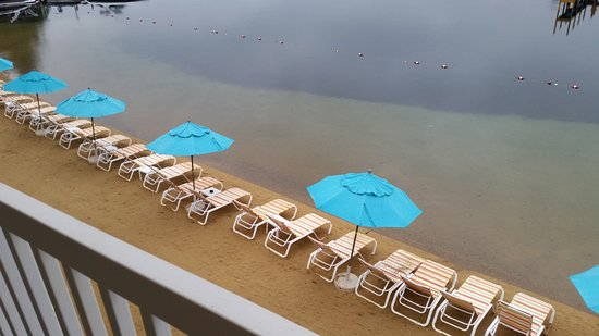 Laconia, NH: Lounge chairs and umbrellas...