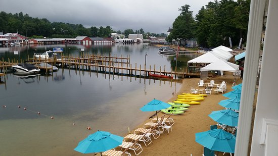 Laconia, NH: Large dock and NazBar Grill with white umbrellas.