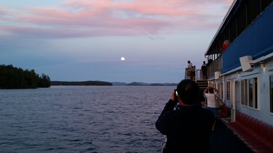 Weirs Beach, NH: Moon rise over Lake Winnipesaukee.