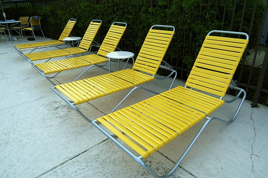 Williston, VT: Yellow chairs by the pool.