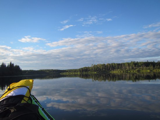 Peace River, Canada: Canoeing on Figure Eight Lake on a summer evening.