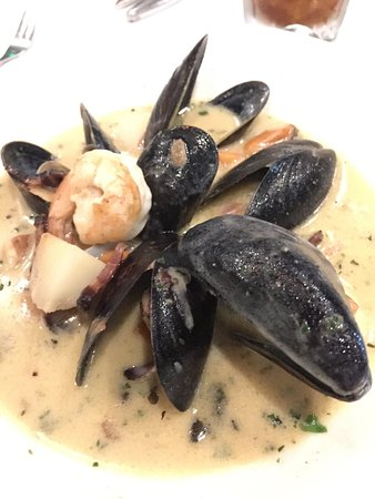 Glendale, CO: Chilean Seabass with cauliflower purée, seafood chowder and steamed mussels appetizer.