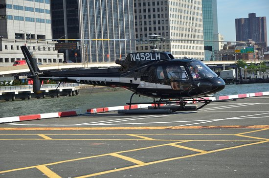 Helicopter Flight Services - Helicopter Tours: The helipad and helicopter