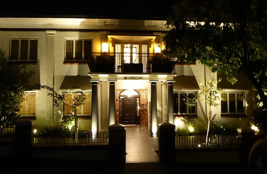 Spicers Balfour Hotel: Renovated Art Deco suite building at night.