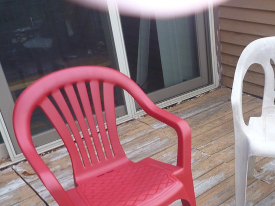Nordic Village Resort: Chair two. As you can see the deck is in need of repair. This is unit H120B
