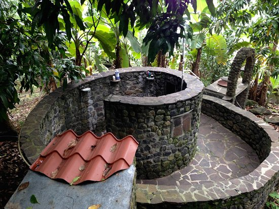 Balgue, Nikaragua: At the Homestead House, shower beneath a mango tree, with solar-powered hot water