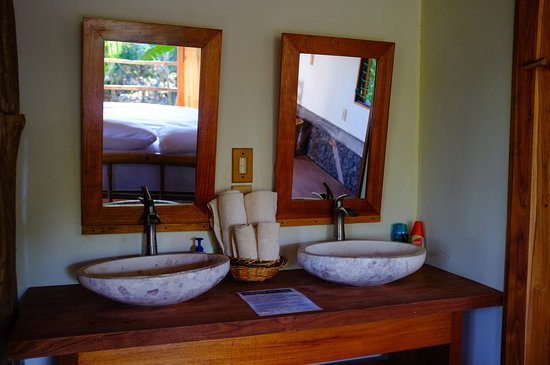 Balgue, Nikaragua: His/her sinks with mirrors at the Volcano View Luxury Suite