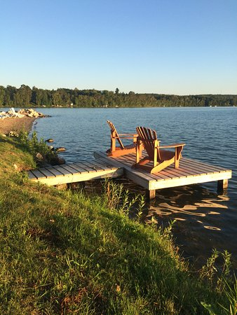 Sugar Lake Lodge: a number of private docks with adirondacks to watch the sunset