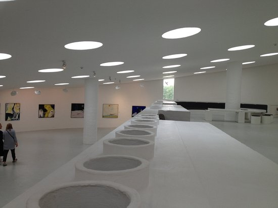Herning, Denmark: The unique itnterior of the museum, with round circular lights in the ceiling.