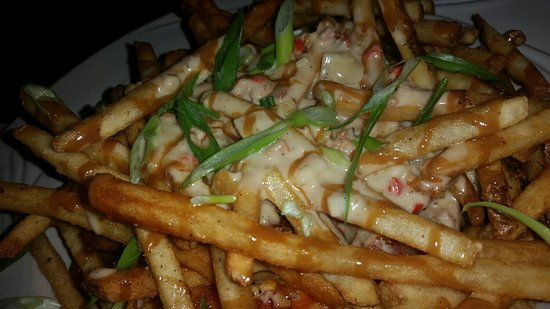 This is what poutine should look like, fries, gravy, and cheese curds.The Gage doesn't serve it