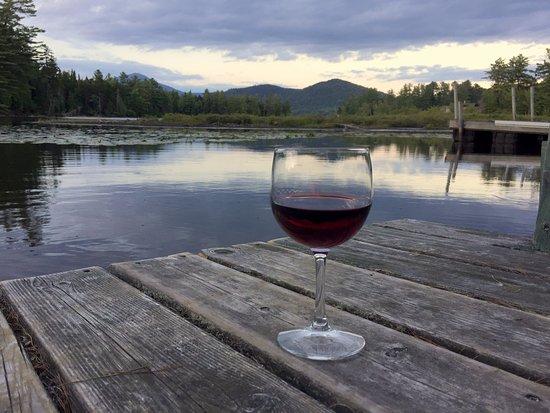 Paradox Lodge & Cedar Lodge: Enjoying a Pinot Noir by the dock