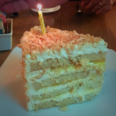 Delicious Pina Colada Cake With Birthday Candle