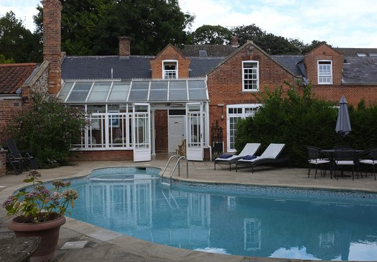 The Dining Room at The Old Rectory: The pool, conservatory and the adjoining Coach House