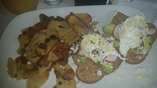 The Plaza Hotel: Breakfast Feature Advacado Toast with poached egg, sliced radish , cracked pepper& feta cheese