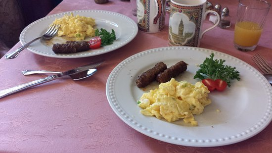 Mooring B&B: Third morning breakfast; delicious scrambled eggs w/cream cheese & scallions & spicy, sweet saus