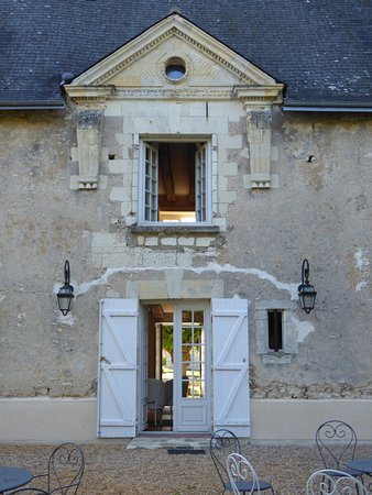 Truyes, France: Entrance to dining room from rear garden and our bedroom above