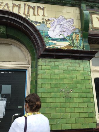 Early tiles on the pub next doors facia, made by Carter, the founder of the Poole Pottery