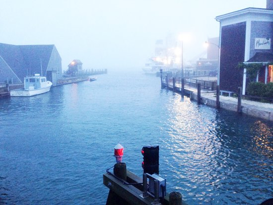 Romantic fog rolls into Woods Hole, shrouding the harbor with it's sweet quiet punctuated by the